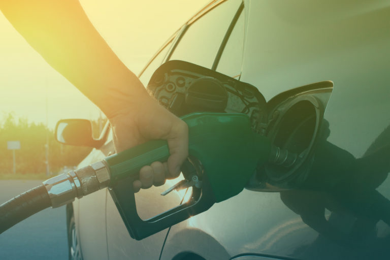 hand-guiding-the-fuel-in-the-car